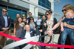 Ribbon-cutting for Storm Fujimoto Industrial Center:  (l-r) Jonathan Beutler, president, HC/HG Chamber, patriarch Sam Fujimoto (seated), son Jon, granddaughter Samantha, daughter-in-law Victoria, grandson Giovanni, daughter-in-law Joyce, son Steve; Elizabeth Storm-McGovern, daughter of Storm Industries' Founder Walter Storm, Elisa Corbin Storm, granddaughter, great-grandson Porter Corbin Storm.