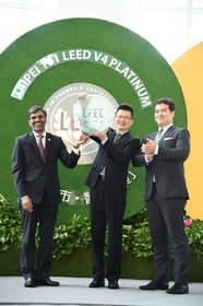 The COO of USGBC Mr. Mahesh Ramanujam presents the LEED v4 plaque to TAIPEI 101 Chairman Joseph Chou. On the right is the Chairman of CTBUH Mr. David Malott.