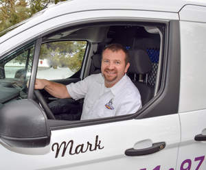 Mark Spurgeon, owner of Dryer Vent Wizard in Oregon's Valley area, prepares to make service calls to residential and commercial customers.