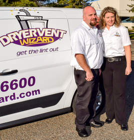 Chris and Diana Elrod are pictured by their Dryer Vent Wizard van.