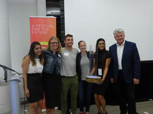 Winners of the Fourth Annual Beantown Throwdown Accept Trophy from MITEF Executive Director Katja Wald and event sponsor SevOne CMO Jim Melvin. From left to right: Simran Bimrah, AskMolly; Wald; Anders Bill, EchoMe; Courtney Wilson, DropZone for Veterans; Shivani Shah, AskMolly; Melvin.