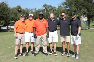 Former UF linebacker and two-time Super Bowl Champion, Wilber Marshall and former UGA kicker and Super Bowl Champion Kevin Butler assemble with their Florida-George golf teams at the Desire Cup.  Each year fans from Georgia and Florida connect and compete at the Desire Cup for a positive cause.