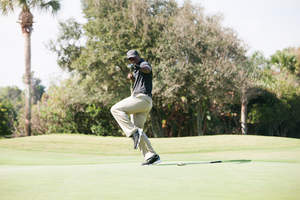 Former UGA quarterback and SEC Champion, D.J. Shockley doing a ¿happy dance¿ during the Desire Cup tournament that will tee off this year on Fri., Oct. 28, at Dye¿s Valley Course at TPC Sawgrass, the sister track to the world famous The PLAYERS Stadium course.