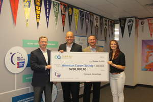 Campus Advantage executives present American Cancer Society representatives with a $200,000 check.