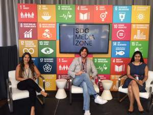 Matthew Bird with team 1-800-PublicRelations team members Dianna Guisti and Sravya Cherla at UN SDG Media Zone