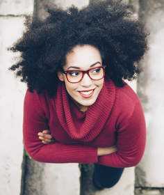 woman in red sweater with glasses