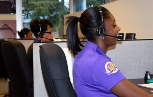 Taking calls in DVW's Customer Wizard Scheduling Center are, from front to back, Ebony Stafford, Gwendolyn Young and Winter Keith.