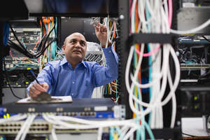Chandra Upadhyay, Sr. Director, Systems Engineering, performs routine testing at Navisite's Andover, Mass., data center