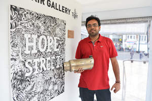Inventor Anirudh Sharma pictured with his Air-Ink™ technology, inside the Tiger Beer 'Clean Air Gallery' in Brixton, London
