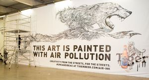 Kristopher Ho draws with  Air-Ink™ made from London air pollution (Image credit - John Sanders photography