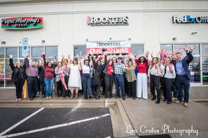 Attendees of Roosters Men's Grooming Center's official ribbon cutting in Torrence Village give an enthusiastic welcome to the new business.