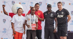 Mission Accomplished: Che Benny, 16, second from left, stands as one of the winners of the Flow Ultimate Football Experience. (L-R)Cindy Ann Gatt, Director of Marketing, Flow Trinidad; Benny; the Honourable Darryl Smith, the Minister of Sport and Youth Affairs from the Republic of Trinidad and Tobago; Dwight Yorke, national footballer for Trinidad and Tobago and Manchester United and Mike Neary, Head Coach for the Manchester United Soccer Schools