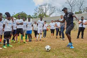 Advice from a Legend: Dwight Yorke, former striker for Manchester United and the National Team for Trinidad and Tobago gives practical advice to a group of young footballers from the Flow Ultimate Football Experience.