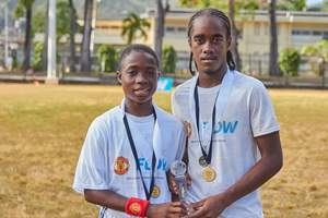 The Ultimate Young Footballers: Ronaldo Flowers, 13, from Antigua (left) and Che Benny, 16, from Trinidad and Tobago -the winners of the Flow Ultimate Football Experience.