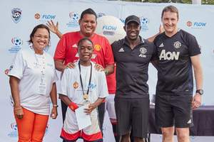 Ultimate Winner: Ronaldo Flowers, 13 from Antigua, one of the winners of the Flow Ultimate Football Experience. With Ronaldo are (from left): Cindy Ann Gatt, Flow's Director of Marketing; the Honourable Darryl Smith, Minister of Sport and Youth Affairs,  Trinidad and Tobago; Dwight Yorke, Manchester United Legend and Mike Neary, Head Coach, Manchester United Soccer Schools