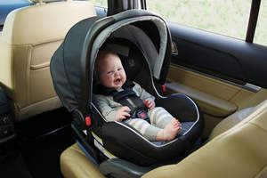 Laughing baby in car seat